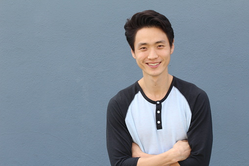 689644378 istock photo Young Asian male smiling and laughing with arms crossed 846731528