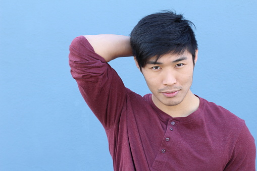 689644378 istock photo Young Asian male smiling with copy space 689644792