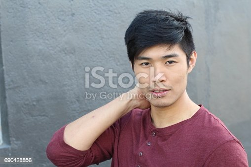689644378istockphoto Young Asian male smiling with copy space 690428856
