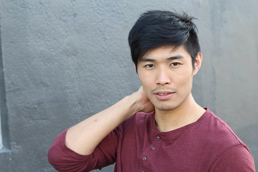 689644378 istock photo Young Asian male smiling with copy space 690428856