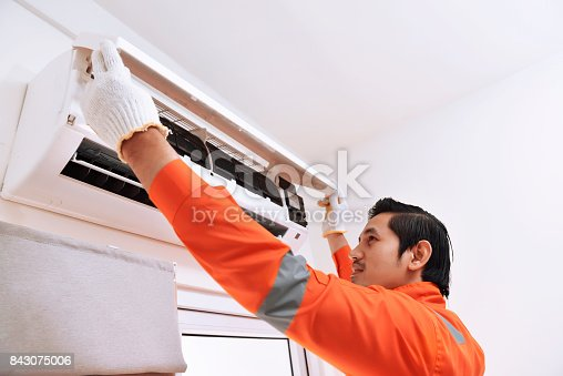 istock Young asian male technician repairing air conditioner 843075006