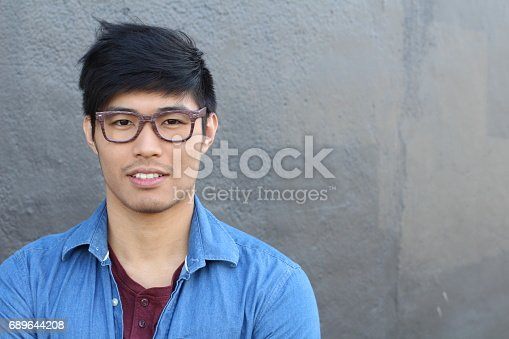 689644378istockphoto Young Asian male with glasses smiling 689644208