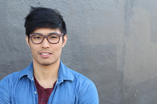 689644378 istock photo Young Asian male with glasses smiling 689644208