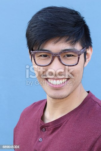689644378istockphoto Young Asian male with glasses smiling 689645004