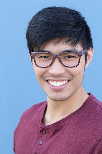 689644378 istock photo Young Asian male with glasses smiling 689645004