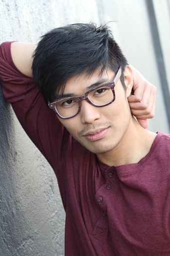 689644378 istock photo Young Asian male with glasses smiling 690428634