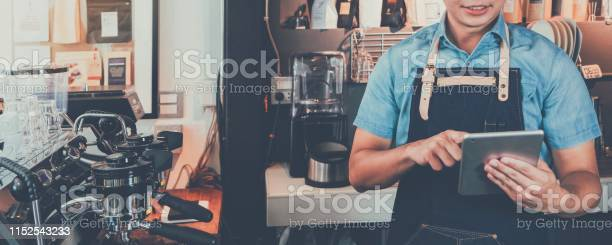 Young asian man barista wear apron using tablet and receive order picture id1152543233?b=1&k=6&m=1152543233&s=612x612&h=kny4lawlr26tgumabdqrwnri9y0hragjkj9wnbf6fvm=