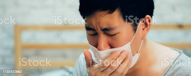 Young asian man coughing and suffering in medical mask inside home picture id1132422662?b=1&k=6&m=1132422662&s=612x612&h=gez6rkm9iymdmyfph9mrs0pkplkcpcrdvgtbvyx sxk=