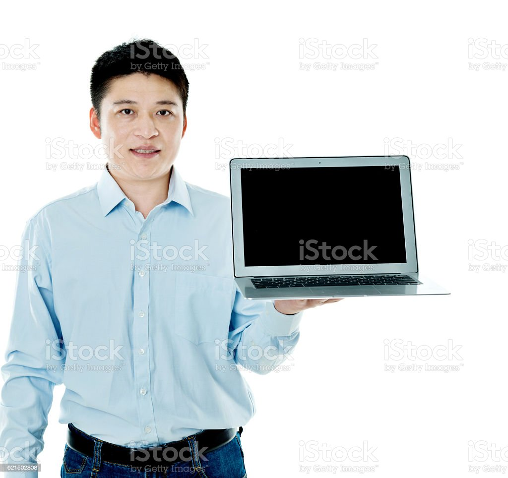 Young asian man holding a laptop computer foto stock royalty-free