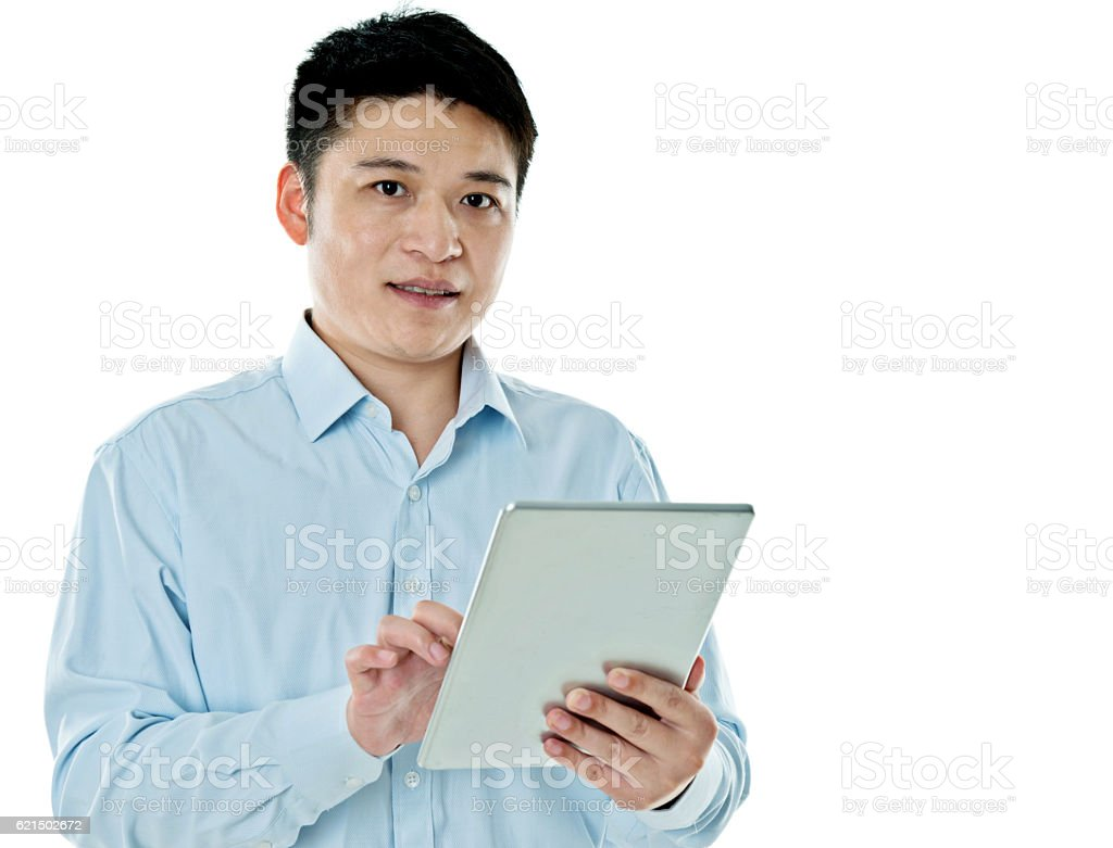 Young asian man holding digital tablet foto stock royalty-free