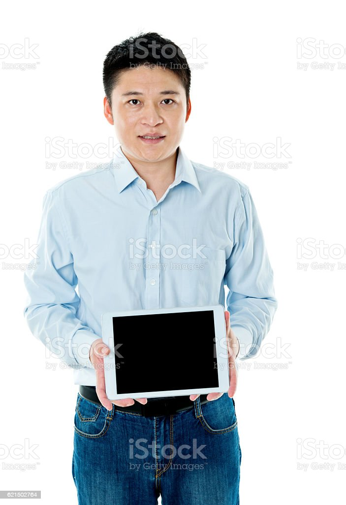 Young asian man holding digital tablet Lizenzfreies stock-foto