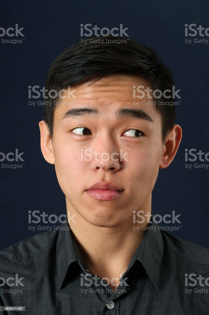 Young Asian man looking sideways stock photo