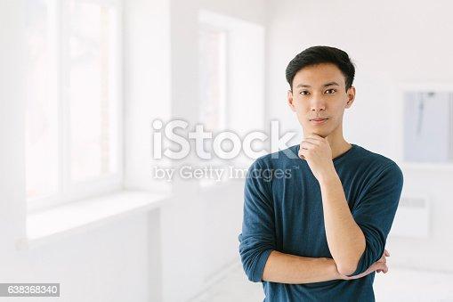 istock Young Asian Man 638368340
