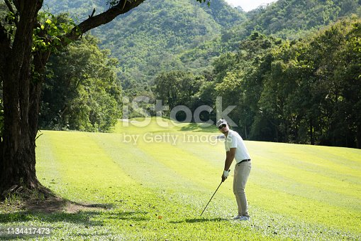 istock Young Asian man playing golf on a beautiful natural golf course 1134417473