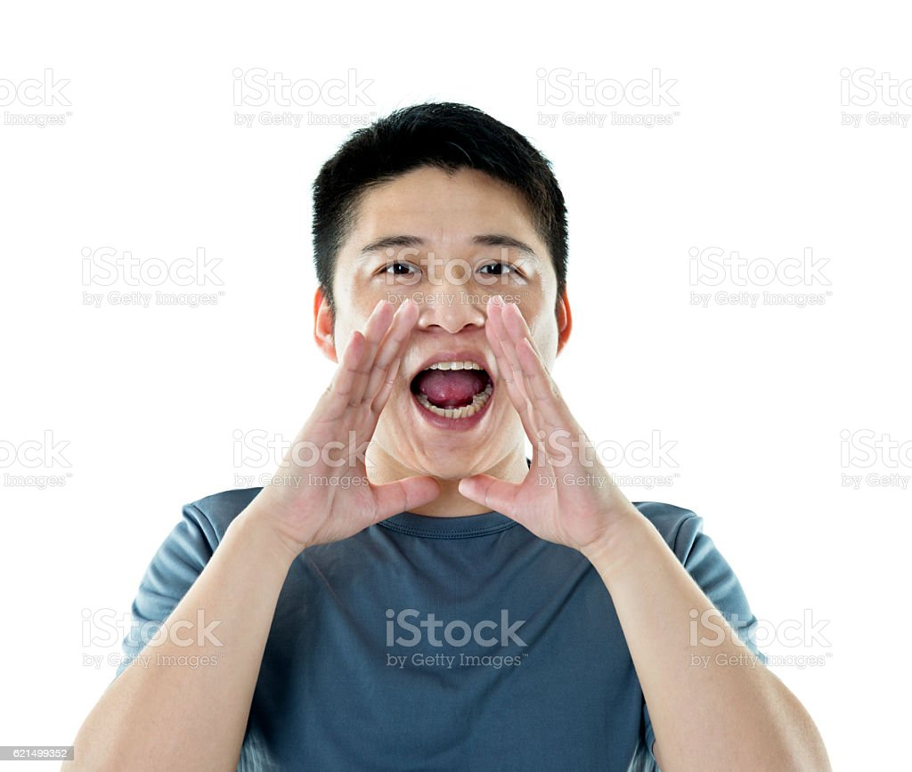 Young asian man shouting against white background Lizenzfreies stock-foto