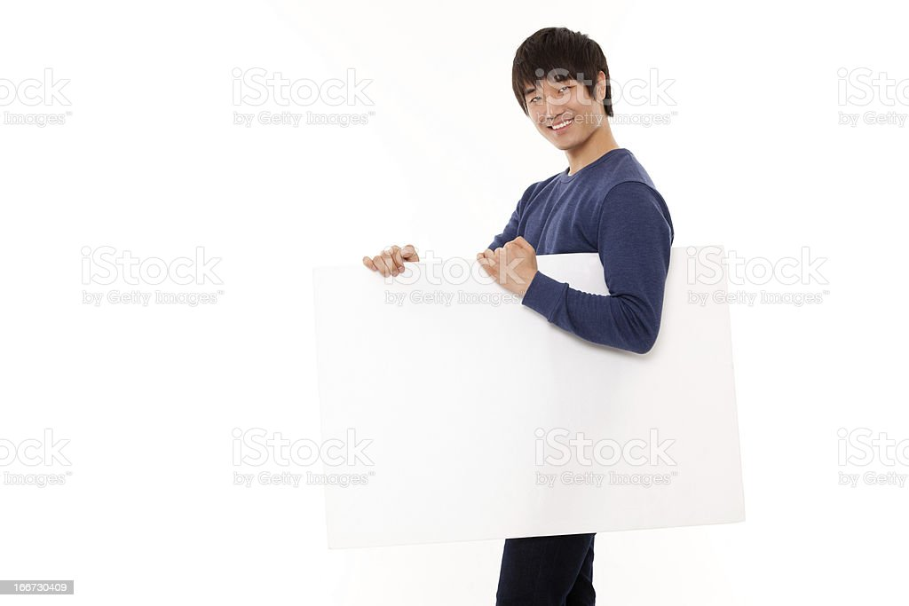 Young Asian man show blank card. royalty-free stock photo