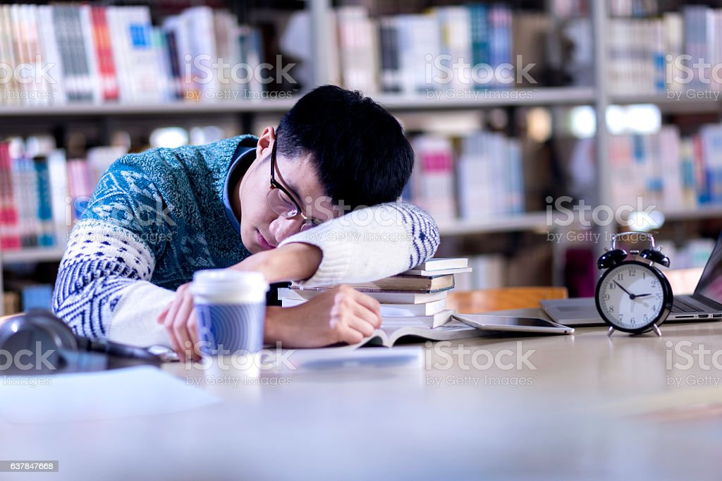 Young Asian Man Student Sleeping In Library Stock Image