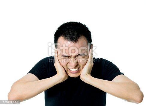 istock Young asian man suffering from headache 479299002