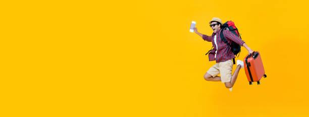 Young asian man tourist jumping with luggage picture id1166716458?b=1&k=6&m=1166716458&s=612x612&w=0&h=x87zdmp1eci9mk88pnbkpteocnvitwzdp1m5l zdgjg=