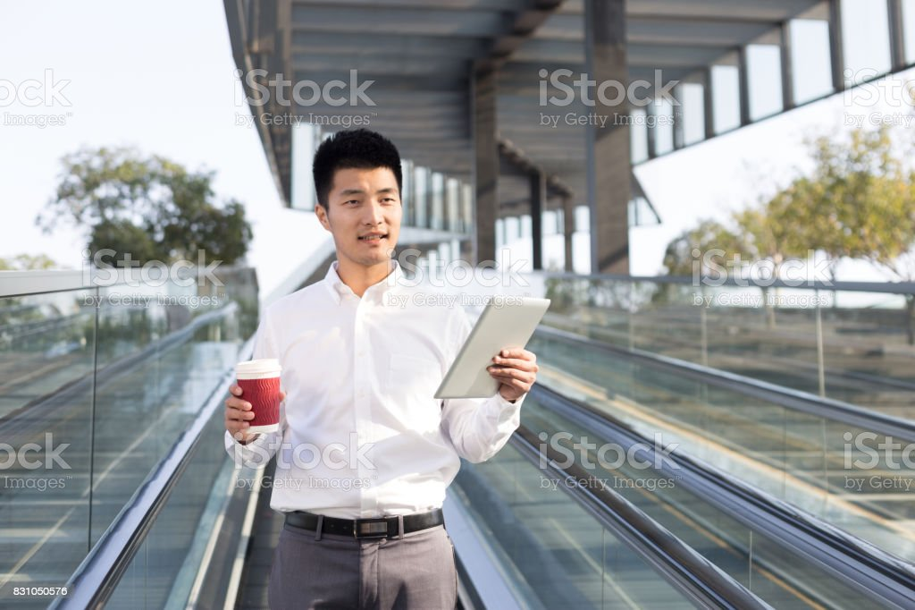 young asian man using mobile phone stock photo