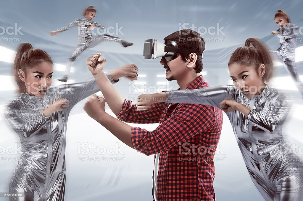 Young asian man using VR headset stock photo