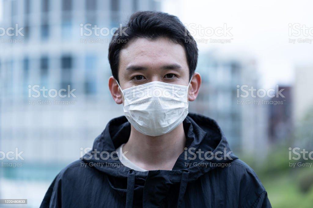 若いアジア人のマスクを着用 - 1人のロイヤリティフリーストックフォト