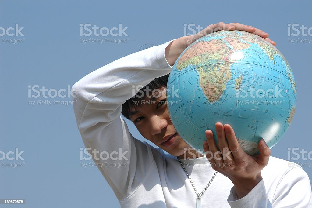 Young Asian Man with a Globe royalty-free stock photo