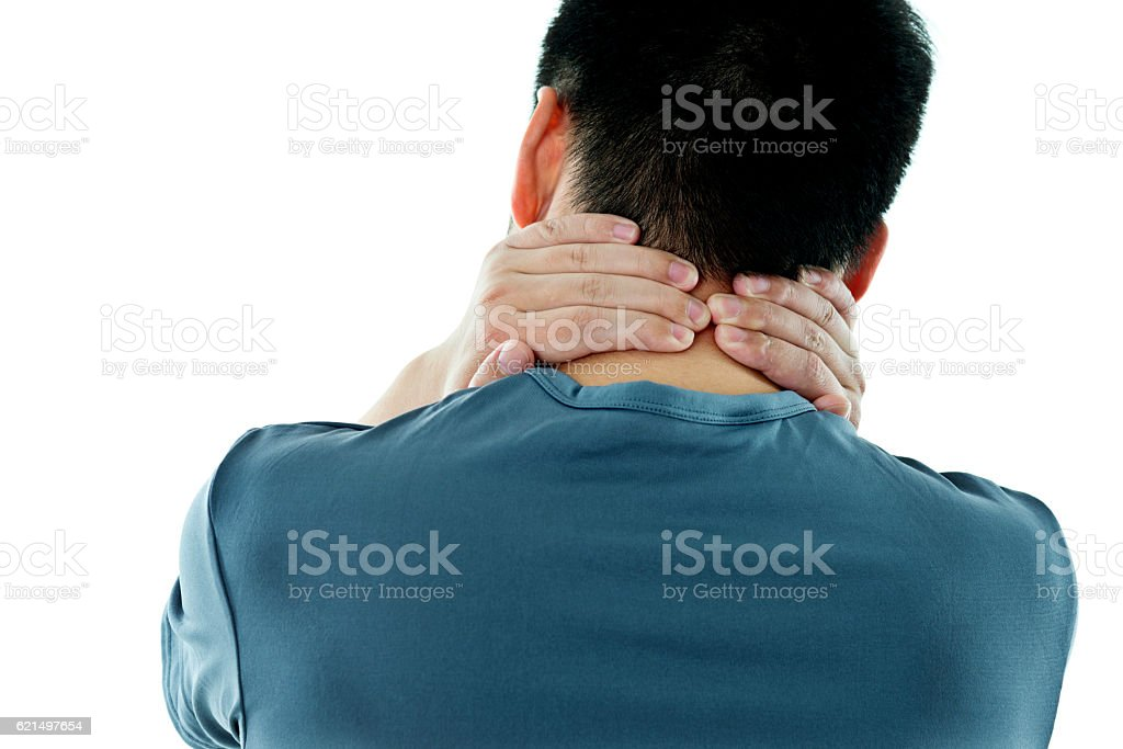 Jeune homme asiatique avec le cou de la douleur photo libre de droits