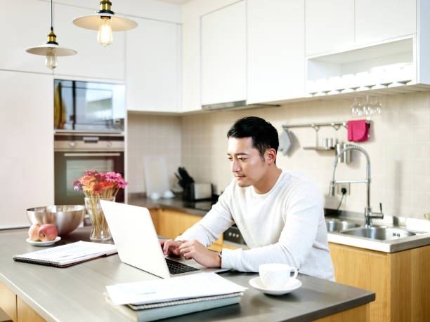 young asian man working at home stock photo