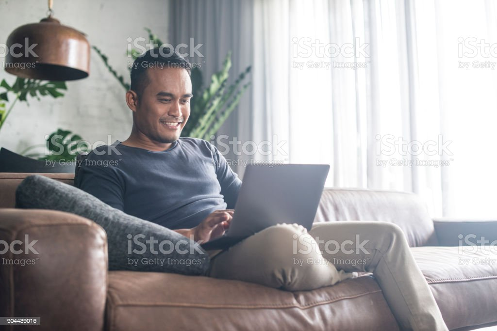 Young Asian man working at home. stock photo