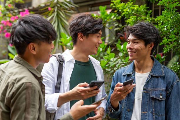Young Asian Men Using Mobile Phones stock photo