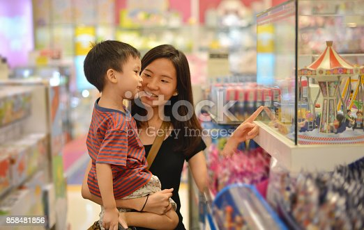 istock Young Asian mother and her kid shopping toy in shopping mall 858481856