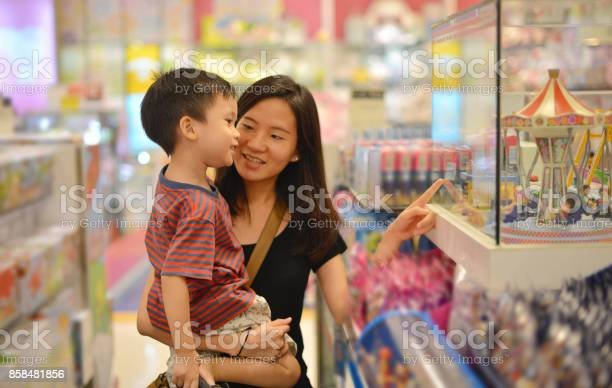 Young asian mother and her kid shopping toy in shopping mall picture id858481856?b=1&k=6&m=858481856&s=612x612&h=urzbydqze2patsba2v duggkbyzhhz6d ymghgqdwuu=