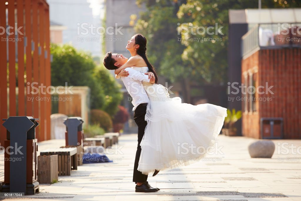 young asian newlywed couple celebrating marriage stock photo