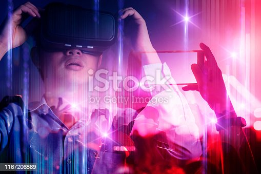 young asian officer man playing and hand touch effect of magic from Virtual reality with in live concert music performance virtual reality atmosphere event