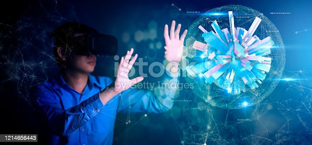 1154261912 istock photo young asian officer man playing and hand touch effect of magic from Virtual reality with black hololens glasses 1214656443