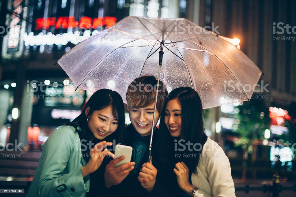 Young asian people making selfie on street stock photo