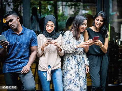 644191686 istock photo Young Asian people using smartphones 956842708