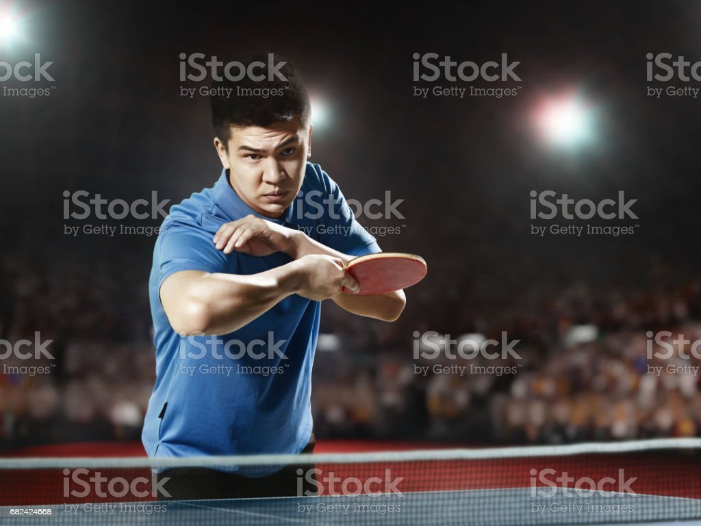 Young asian ping pong player playing table tennis game royalty-free stock photo