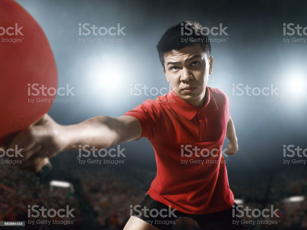 Young asian ping pong player playing table tennis game stock photo