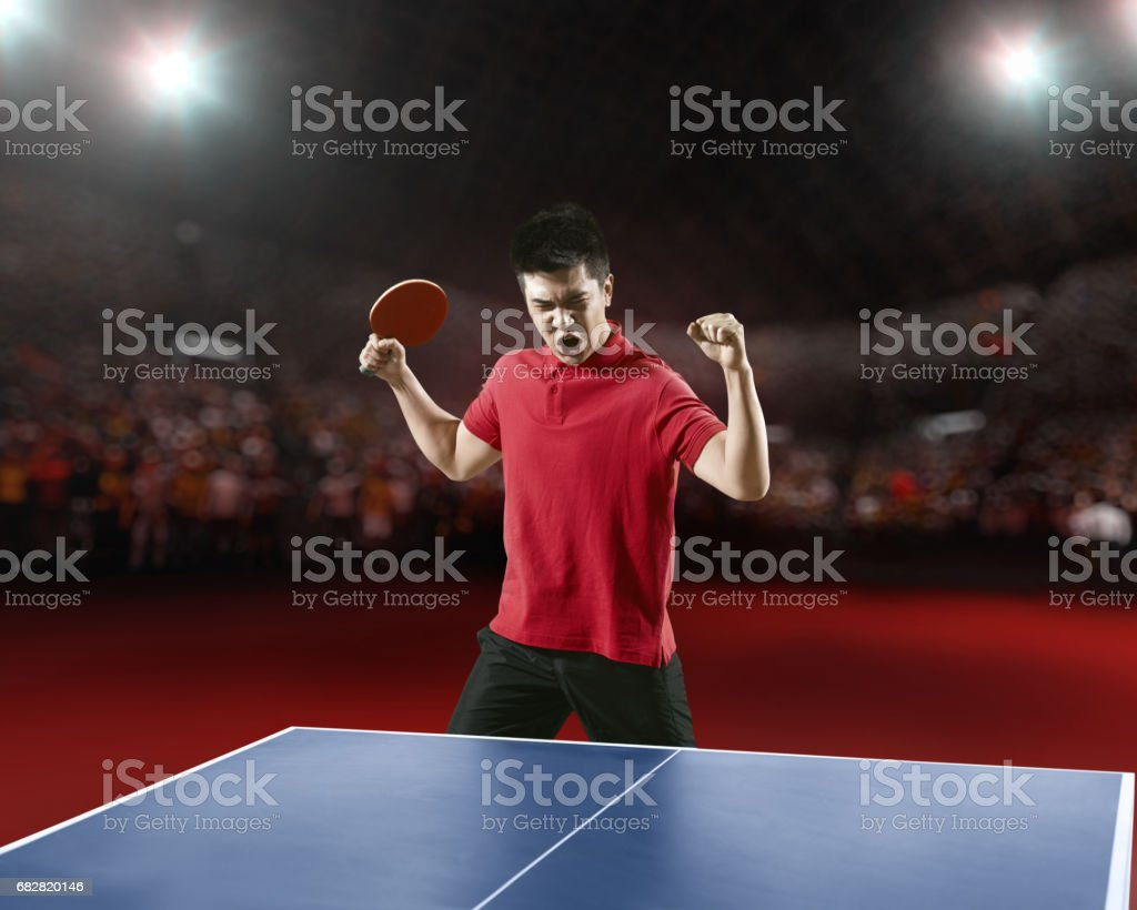 Young asian ping pong player rejoices in his victory stock photo