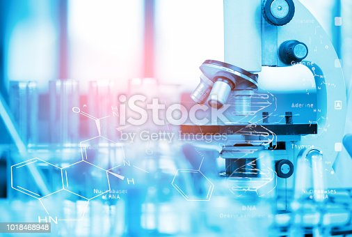 istock Young Asian Scientist are certain activities on experimental science like mixing chemicals or entry data to develop medicine, foods for everyone on the world, film effect. 1018468948