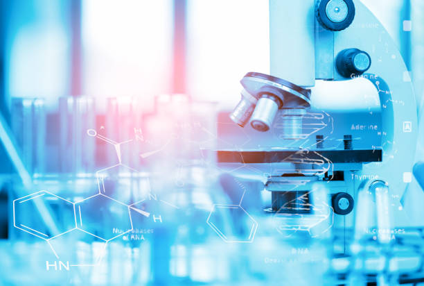 Young Asian Scientist are certain activities on experimental science like mixing chemicals or entry data to develop medicine, foods for everyone on the world, film effect. stock photo