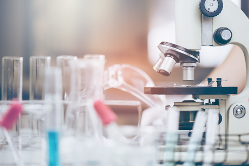 istock Young Asian Scientist are certain activities on experimental science like mixing chemicals or entry data to develop medicine, foods for everyone on the world, film effect. 1018468972