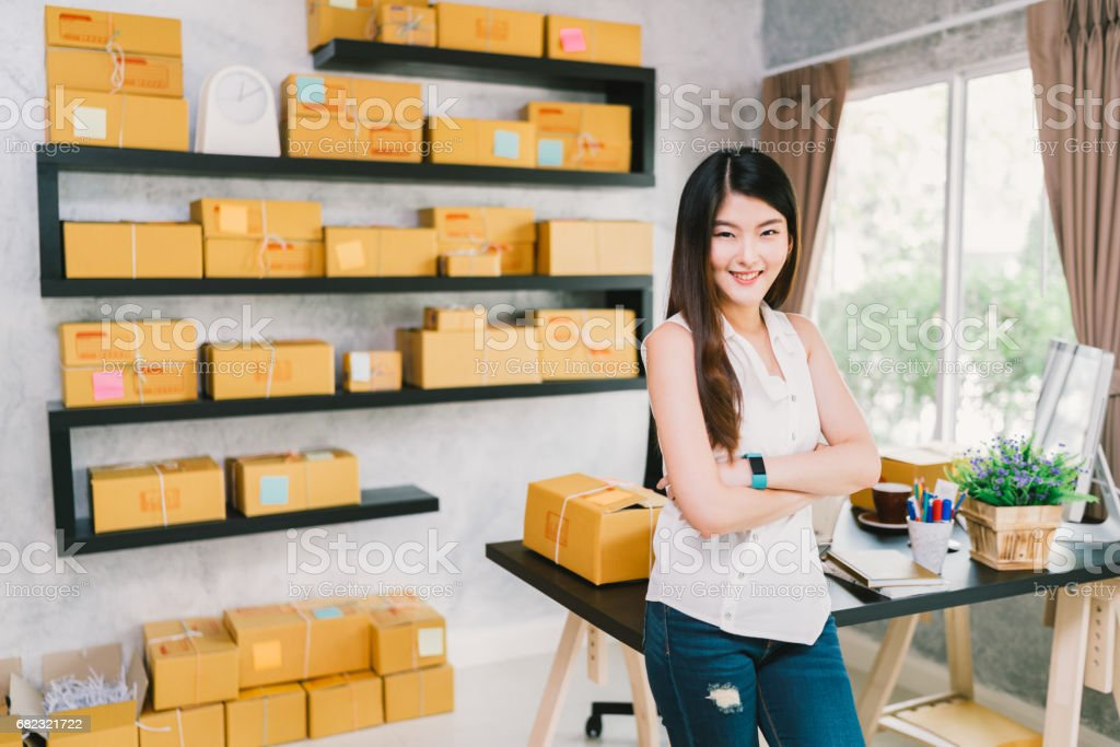 Young Asian small business owner at home office, online marketing packaging and delivery scene, startup SME entrepreneur or freelance woman working at home concept Young Asian small business owner at home office, online marketing packaging and delivery scene, startup SME entrepreneur or freelance woman working at home concept Adult Stock Photo