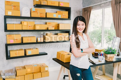 istock Young Asian small business owner at home office, online marketing packaging and delivery scene, startup SME entrepreneur or freelance woman working at home concept 682321722