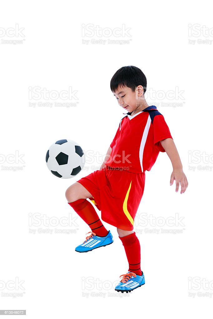 Young asian soccer player with soccer ball. Studio shot. stock photo