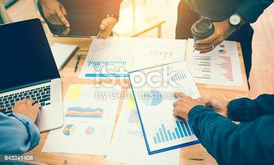 istock Young asian startup team doing a brainstorming about chart and analyze at home office. 843241408