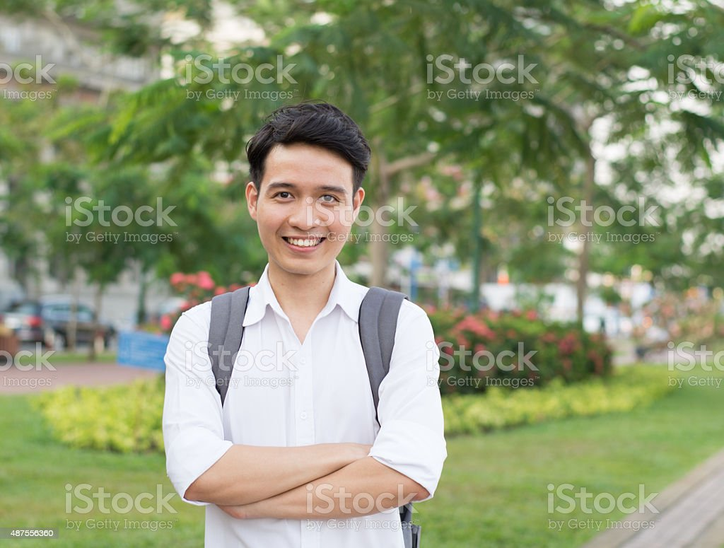 Young Asian student executive with his smiling stock photo