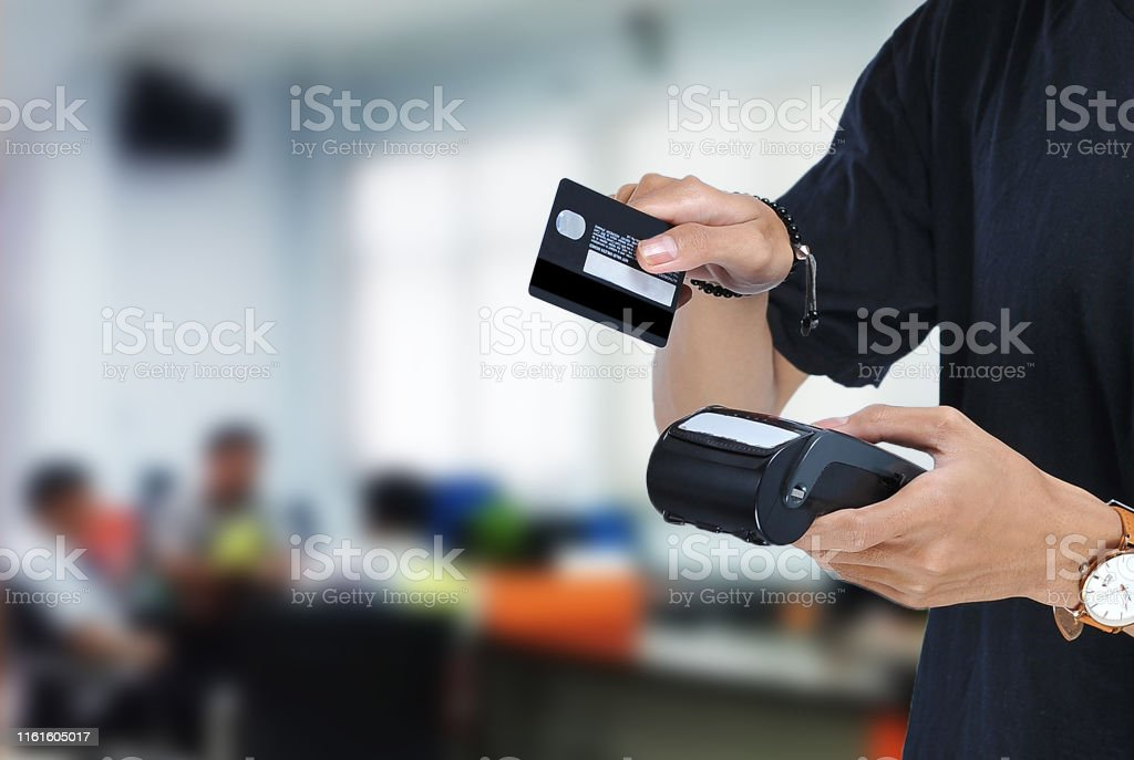 Young asian student holding an Electronic Data Capture machine and...